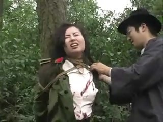 Chinese army girl tied to..